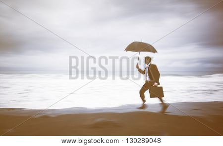 Worried Businessman Running by the Beach Concept