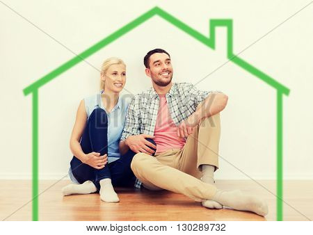 home, people, accommodation, moving and real estate concept - happy couple of man and woman sitting on floor at new place