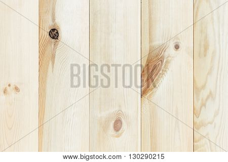 The light beige plank. The wood texture. The background. The vertical plank.