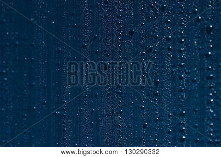 Water drops on the background. Condensate. Indigo background. Water drops background.