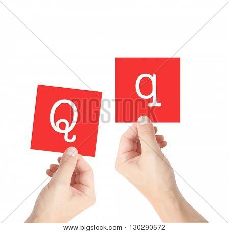 Q written on cards held by hands