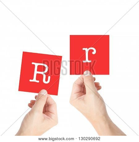 R written on cards held by hands