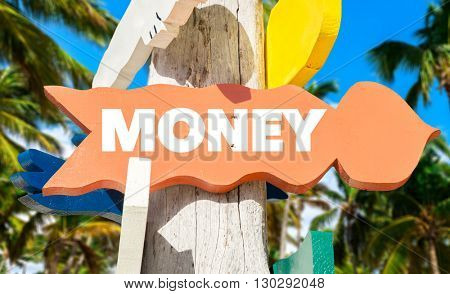 Money direction sign in a tree