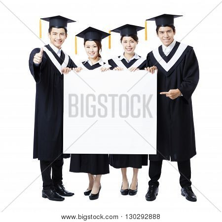young Group of graduate students presenting empty banner