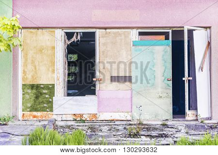 Old colorful metal door with with plywood sheets