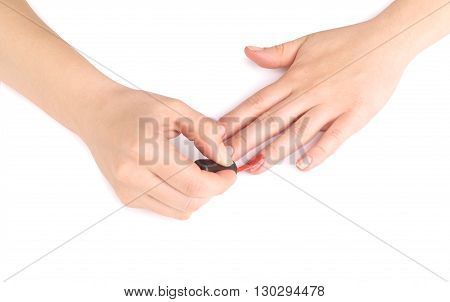woman paints her nails isolated on a white background