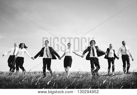 Business People Holding Hands Together Outdoors Concept