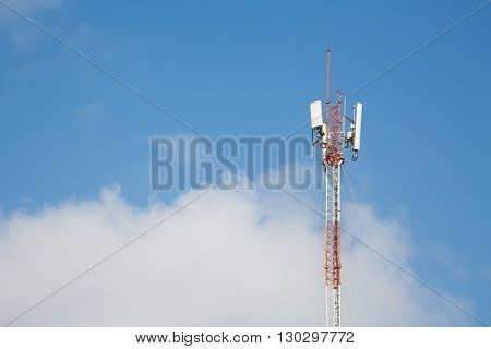 Cell phone communications antenna against a blue sky