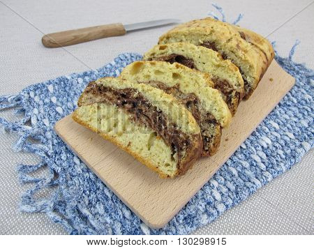Homemade marble cake with light batter, dark batter