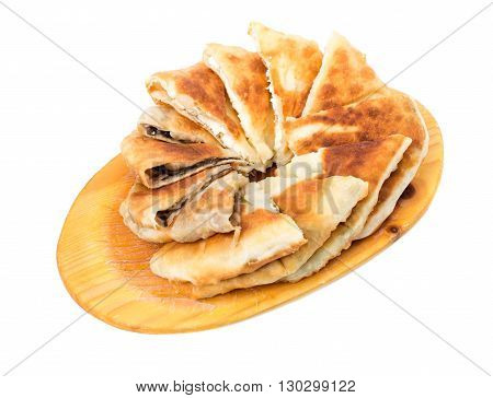 Delicious sliced puff pie stuffed with mushrooms and eggs. Isolated on a white background.