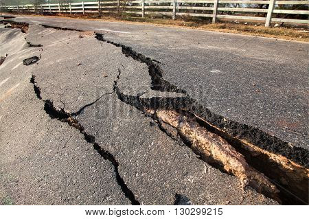 Layer of broken asphalt road at rural areas after earthquake