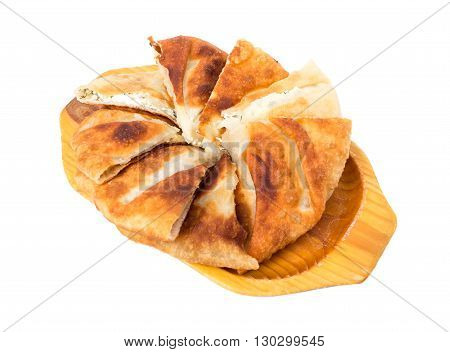 Delicious sliced puff pie with curd cheese and fresh dill. Isolated on a white background.