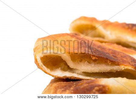 Delicious sliced puff pie with potatoes. Macro. Photo can be used as a whole background.