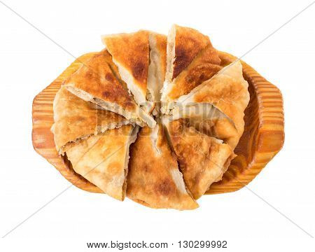Delicious sliced puff pie stuffed with baked cabbage. Isolated on a white background.