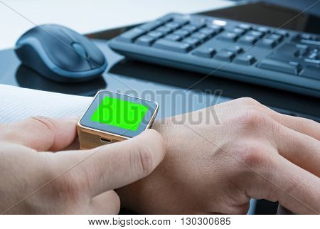 Business Man Using His Smartwatch App With Chroma Key Green Screen, New Technology Concept