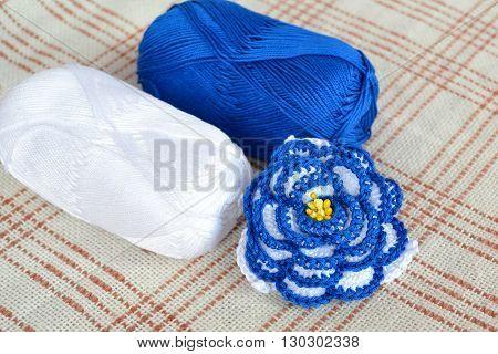 Crochet flower, crochet flower and yarns. Knitting craft concept