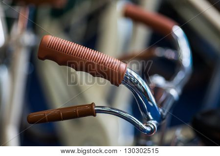 Color detail shot of the brake lever on a vintage bicycle.