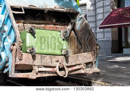Rubbish Container In A Rubbish Truck