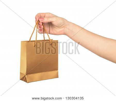 female hand hold a gold gift bag isolated on white background