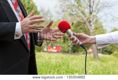 Reporter making interview with businessperson or politician.