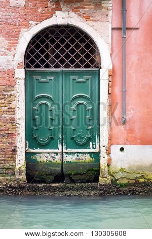 old and ancient wooden doors or gate closeup for a vintage architectural background
