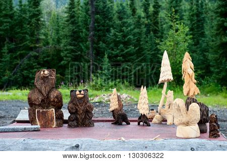 Wood Carved Bears And Trees In Cooper Landing Alaska