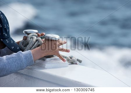 Children Hands While Holding Boat Bollard