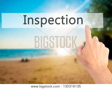 Inspection - Hand Pressing A Button On Blurred Background Concept On Visual Screen.