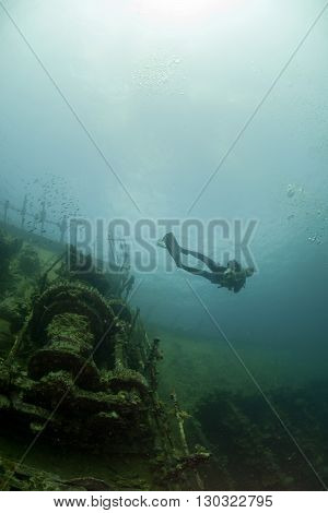 A Scuba Diver Outside Umbria Ii World War Ship Wreck In Red Sea