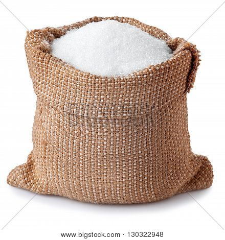 sugar in burlap sack isolated on white background. Full bag of sugar crystals closeup