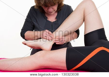 Female Physio Therapist Hands Working On Male Patients Legs