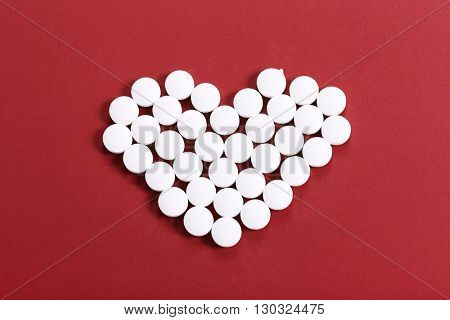 Pharmaceutical. White tablets on the table