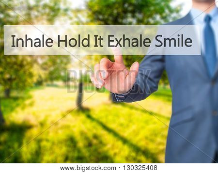 Inhale Hold It Exhale Smile - Businessman Hand Pressing Button On Touch Screen Interface.
