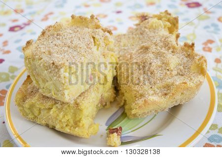 wedge of focaccia bread stuffed with slices of bologna on a black and white background