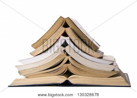 Horizontal front view of a pile of open books standing on top of each other isolated on white background