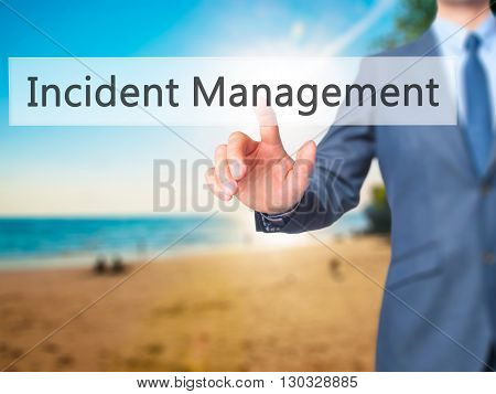 Incident Management - Businessman Hand Pressing Button On Touch Screen Interface.