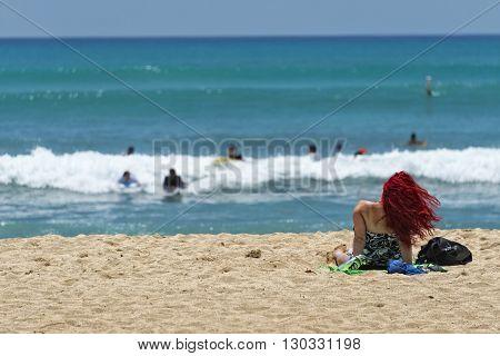 Beautiful Girl Relaxing On Waikiki Beach