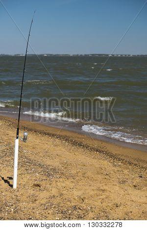 fishing pole on the sandy beach view