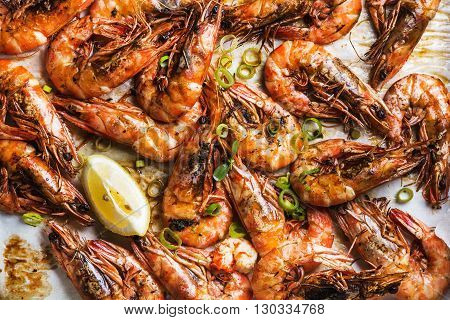 Roasted tiger prawns with fresh leek and lemon, top view