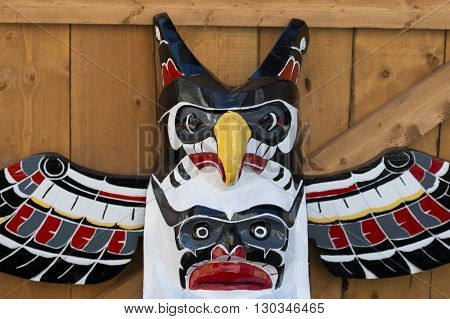 Isolated totem wood pole head detail detail close
