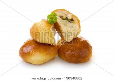 Bun  with pickled vegetable filling isolated, cut in half on a white background.