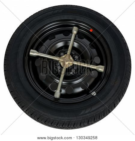 Car service concept, tire with screwdriver. Top view, isolated on white