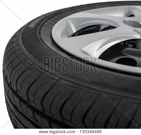 Close up new car tyre. Isolated on white