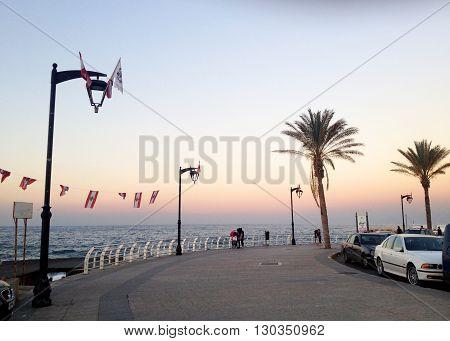 Beirut, Lebanon -  December 24, 2015: People take their sunset walk on the famous Corniche (seaside promenade) in Beirut, Lebanon