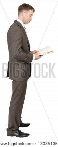 Businessman reading book isolated on white background. Side view