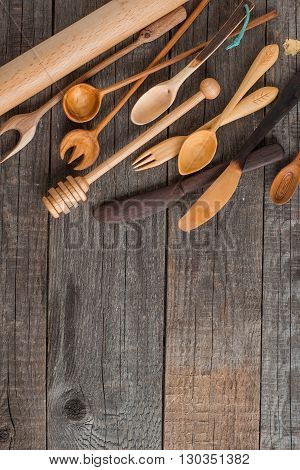 handmade various wooden kitchen utensils on vintage table background