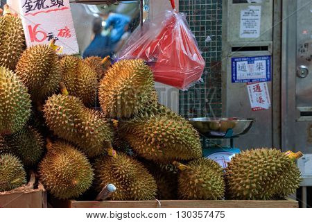 Hong Kong, Special Administrative Region of the People's Republic of China - 19 April 2016: Durians sold on traditional asian market