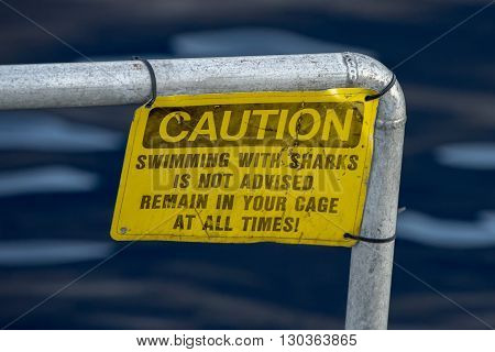 Caution Swiimming With Sharks Yellow Sign