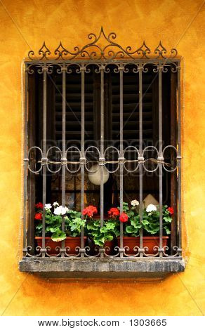 European Window Full Of Red And White Geraniums