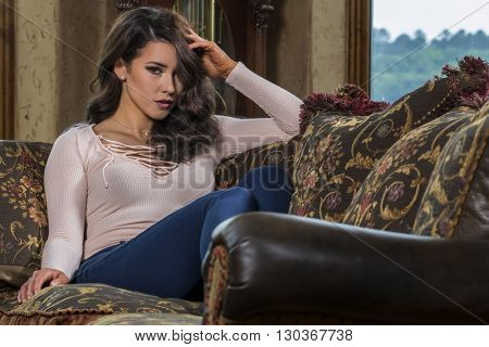 Young brunette model relaxing at home